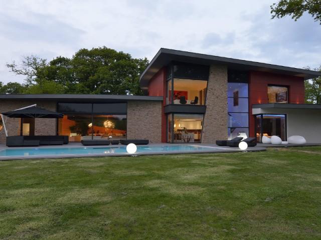 Une terrasse aux formes arrondies pour une ambiance conviviale - Une maison contemporaine inspirée par les yachts