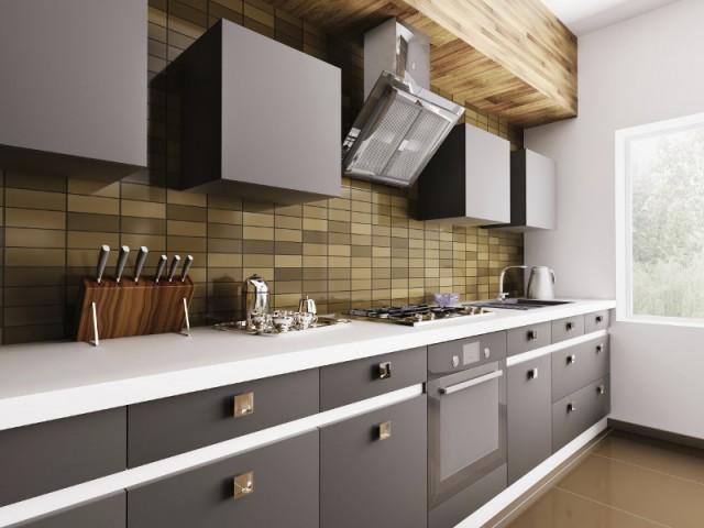Une cuisine équipée d'appareils électroménagers