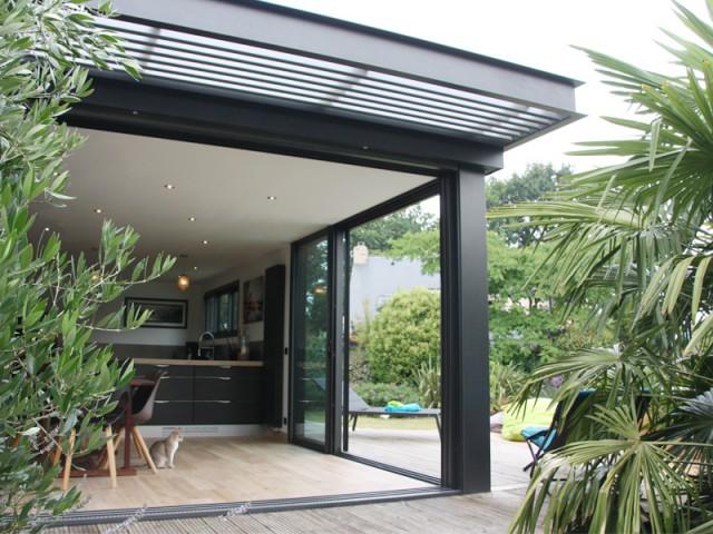 Une véranda bois et toiture plate - Concept Alu