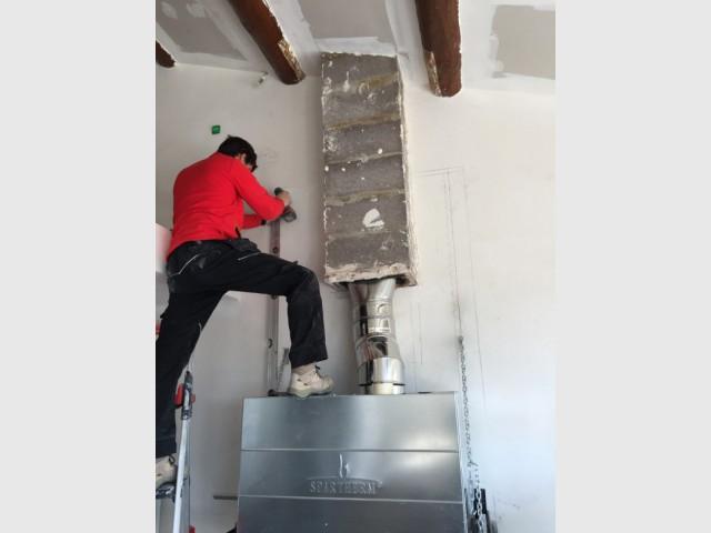 Installation de la nouvelle cheminée