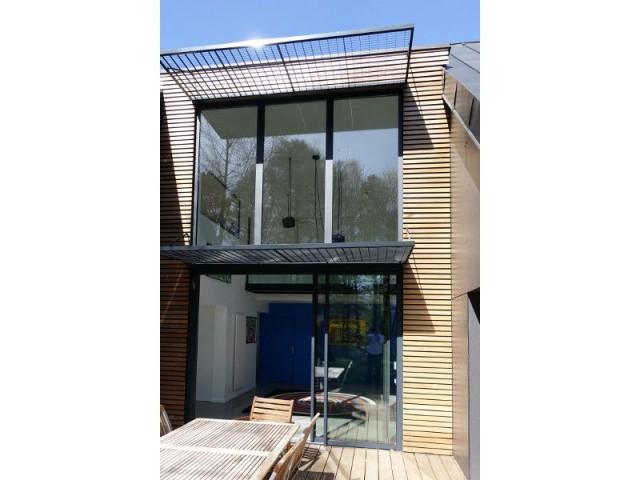 ...Aux façades - Rénovation maison des années 80 en villa contemporaine