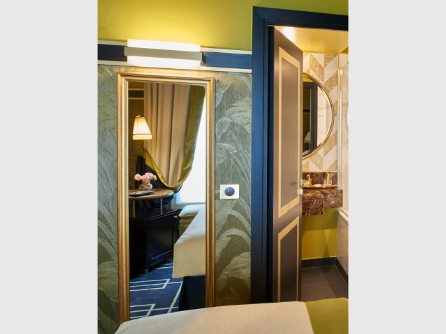 L'une des chambres Opale jaune de l'hôtel Maison Nabis Paris