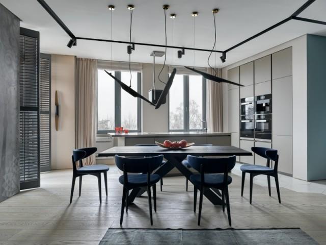 Une grande pièce à vivre mêlant cuisine, salle à manger et salon