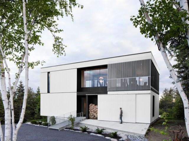 Une maison contemporaine comme un bloc blanc dans la nature