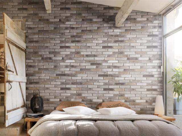 Un mur en briques de parement pour un jeu intérieur/extérieur