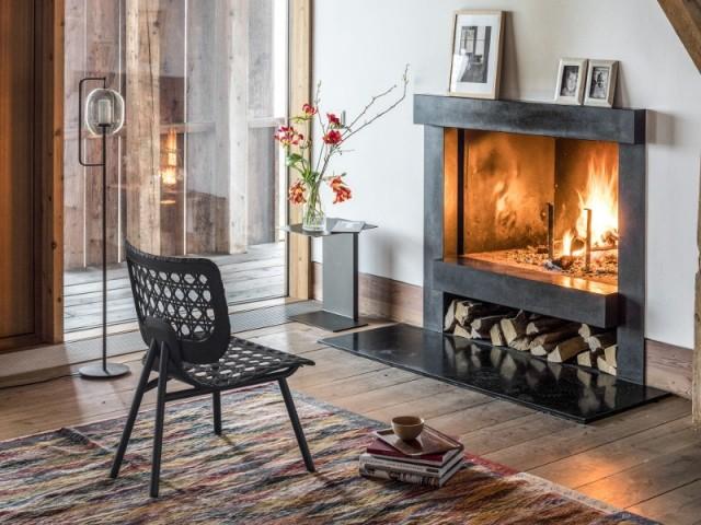 Fauteuil Aërias Lounge, cannage en cuir tressé noir, 2.982 €, en vente chez Made in Design