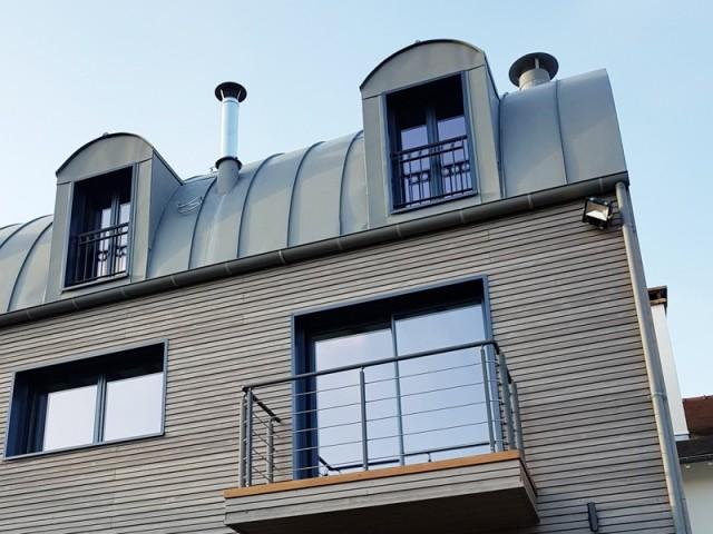 Une toiture en zinc tout en courbes