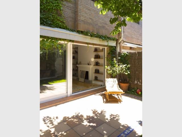 Une terrasse entre intérieur et extérieur