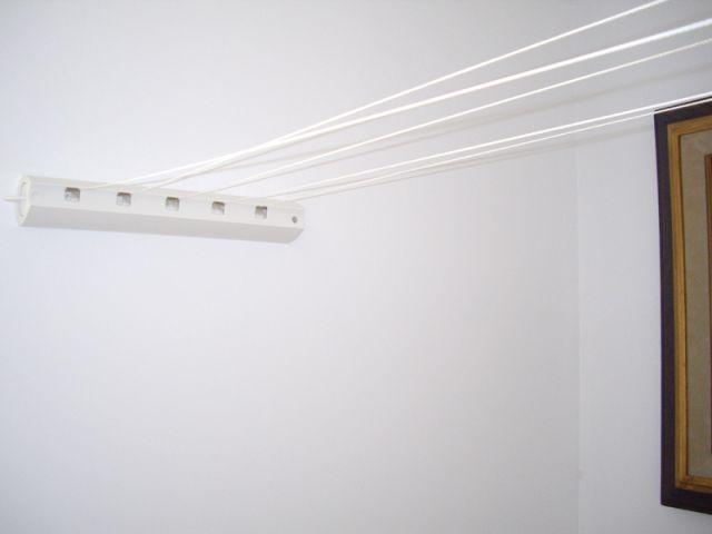 installer un enrouleur de corde linge. Black Bedroom Furniture Sets. Home Design Ideas