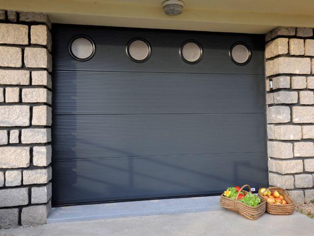 bien choisir sa porte de garage. Black Bedroom Furniture Sets. Home Design Ideas